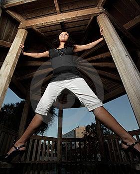 Woman Spread On A Gazebo Stock Photography - Image: 7891292