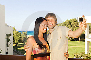 Young Couple Taking A Photo Of Themselves Stock Photo - Image: 7895300