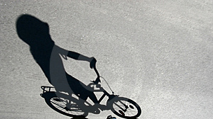 Shade Of Child On A Bike Royalty Free Stock Images - Image: 792459