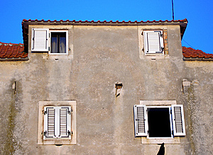 Wall With Four Windows Two Of Wich Is Open Royalty Free Stock Photography - Image: 7902177