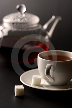 Cup of tea and tea pot Stock Photos