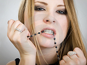 Girl With Beads Stock Photo - Image: 7910570