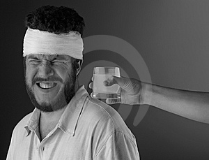 Man with head bandage