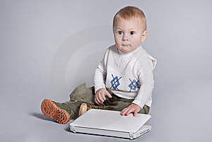 Small Baby With White Laptop Royalty Free Stock Photos - Image: 7918558
