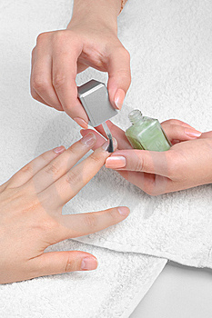 Applying manicure, moisturizing the nails Stock Photos
