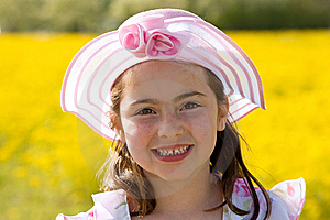 Girl Smiling In Front Of Flowers Stock Photo - Image: 7927580
