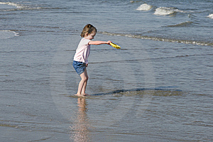 Little Girl Playing On Beach Stock Photography - Image: 7927792