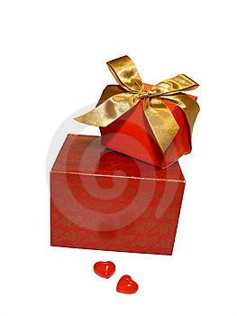 Two Red Gifts With A Gold Ribbon And Two Hearts Royalty Free Stock Image - Image: 7928286