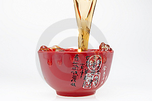 Pouring Tea Into Red Teacup Stock Photo - Image: 7930680