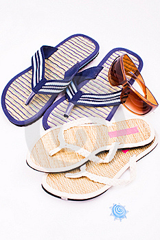 His And Hers Flip Flops And Sunglasses Stock Photos - Image: 7932413
