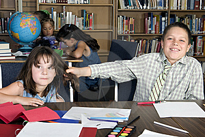 Elementary Student Gets Her Hair Pulled In Library Royalty Free Stock Photos - Image: 7933968