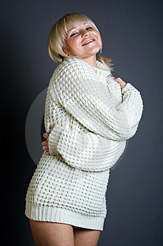 Sexy Blond Woman In Sweater Over Gray Background Royalty Free Stock Photos - Image: 7934528