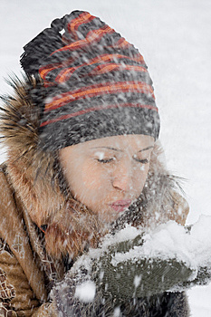 Young Woman Blows On Snow Royalty Free Stock Photos - Image: 7937958