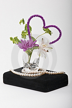 Flowers In A Glass With Pearls On A Jewelry Box Stock Photos - Image: 7943963