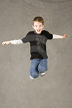 Little Boy Leaping In Air Royalty Free Stock Photos - Image: 7945468