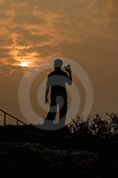 Photographer Facing Sunset Royalty Free Stock Photography - Image: 7962537