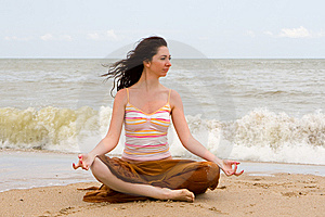 Meditation in the beach Stock Photos