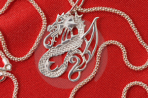 Silver Necklace - A Dragon. Royalty Free Stock Photography - Image: 7975247