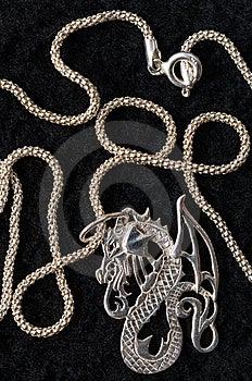 Dragon - A Silver Necklace. Royalty Free Stock Photos - Image: 7976388