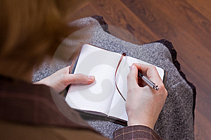 Female Writes Notes In Notebook Stock Photos - Image: 7979693