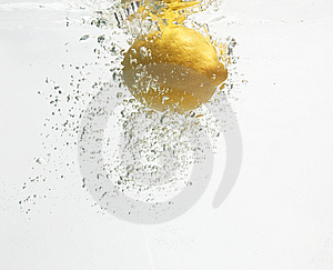 Lemon Is Dropped Into Clean Water #2. Stock Image - Image: 7980311