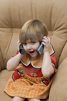The Little Child With Phone Stock Photos - Image: 7992563