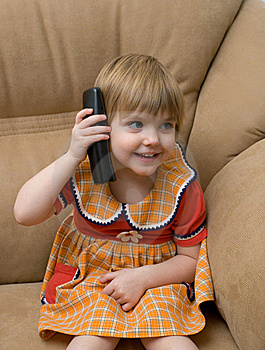 The Little Child With Phone Stock Images - Image: 7992624