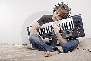 Man Hugs A MIDI-keyboard Royalty Free Stock Photo - Image: 7993545