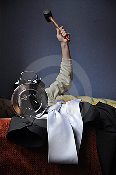 Destroying Alarmclock With Hammer Royalty Free Stock Image - Image: 7995236
