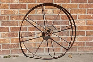 Old Iron Wheel And Brick Wall Free Stock Photography