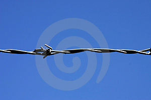 One strand of barbed wire. Stock Photo