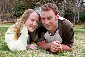 Young Couple Posing in Grass Stock Photo