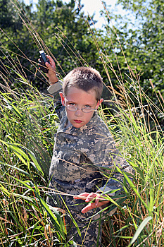 Boy In Camoflauge Raising Arm To Throw Grenade Stock Photo - Image: 8020020