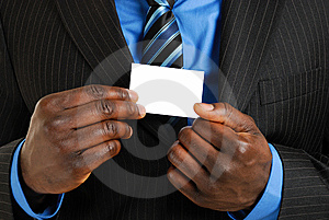 Business man with business card Stock Images