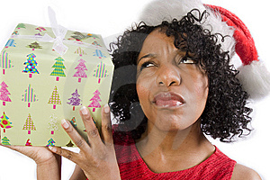 Woman Guessing Her Gift Royalty Free Stock Photography - Image: 8027667
