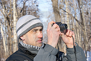 The Man Photographes In The Winter Royalty Free Stock Photos - Image: 8041128