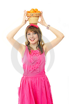 Beautiful Girl With A Basket Full Of Tangerines Royalty Free Stock Photography - Image: 8050487
