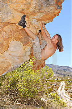 Rock Climber On Boulder With Legs Up Royalty Free Stock Photo - Image: 8059605