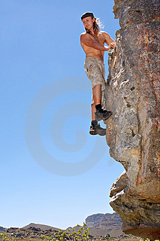 Young Rock Climber Looks Down From Rock Royalty Free Stock Image - Image: 8059646