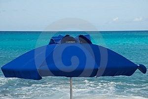 Blue Umbrella Against Blue Sea Stock Photography - Image: 8062902