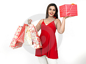 Young Woman With Shopping Bags And Gift Royalty Free Stock Photo - Image: 8067345