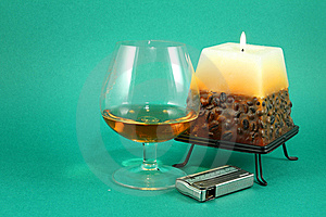 Glass Of Cognac And Burning Cand Royalty Free Stock Image - Image: 8084626