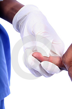 Nurse and a Diabetic Finger Stick Royalty Free Stock Photos