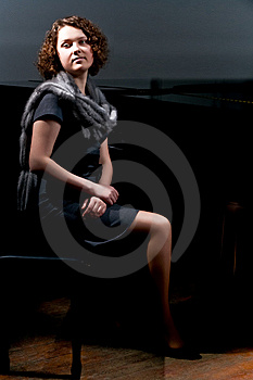 Pretty Young Lady Sitting Near Black Piano Stock Image - Image: 8107701