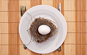 Egg In A Nest Served On A Plate Royalty Free Stock Photo - Image: 8110045