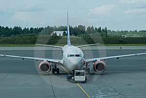 Passenger Airplane Being Pushed Back Stock Photo - Image: 8119690