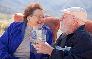 Happy Senior Adult Couple With Drinks Stock Photos - Image: 8120583