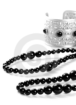 Bracelet And Black Necklace Royalty Free Stock Photography - Image: 8127167