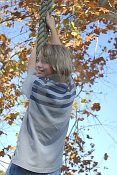 Boy On Tire Swing 2 Royalty Free Stock Image - Image: 8127546