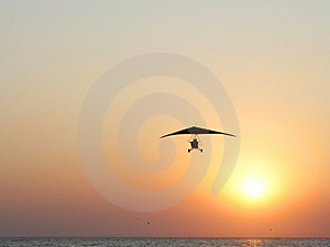 Hangglider In Action Against A Sea Sunset Stock Photo - Image: 8136080